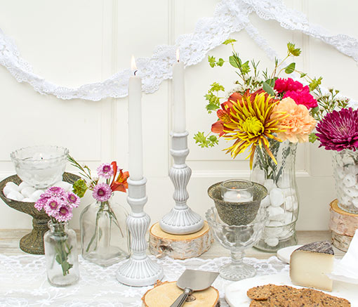 Fit white taper candles in these holders and style the set on a lace table runner with clear glass vases, rustic compotes, flowers and votive candles.