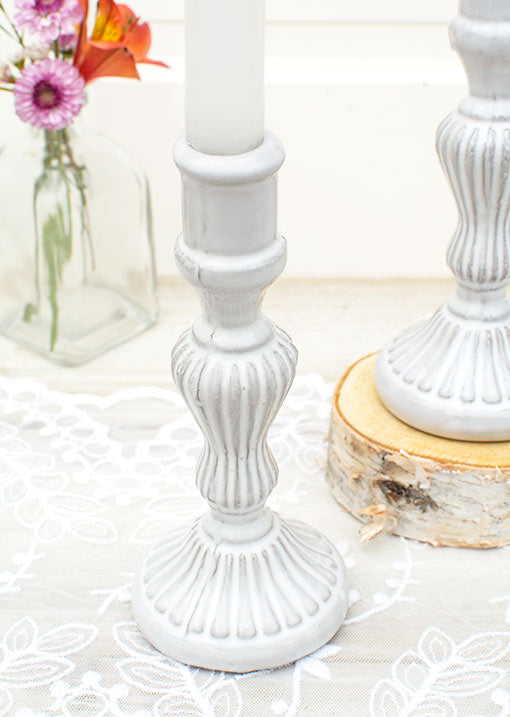 Each 7 inch tall candlestick has a 0.75 inch diameter opening to fit most taper and stick candles.