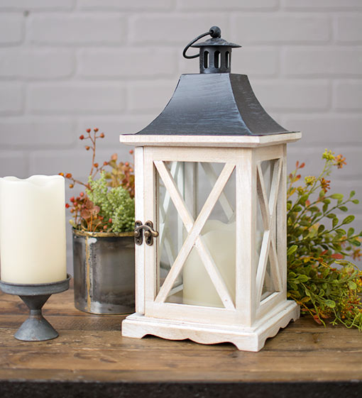 Style this candle lantern as a centerpiece in your wedding with a flameless candle on our mini metal pedestal and alongside a heat patina vase filled with sprigs and sprays.