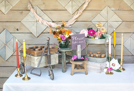 Complete your favors table with colorful candles, metallic candle holders, glass bottles, vases and signage.