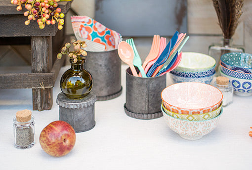 Your rustic luncheon or brunch is made more vibrant with the addition of these colorful patterned morsel bowls! Festive picnic utensils and clear, food-safe bottles set your table.