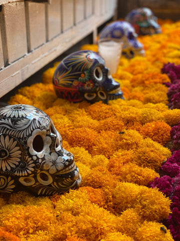 dia de los muertos marigold flowers and sugar skulls