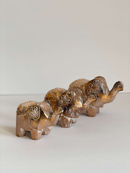 hand-carved wooden elephant family gold