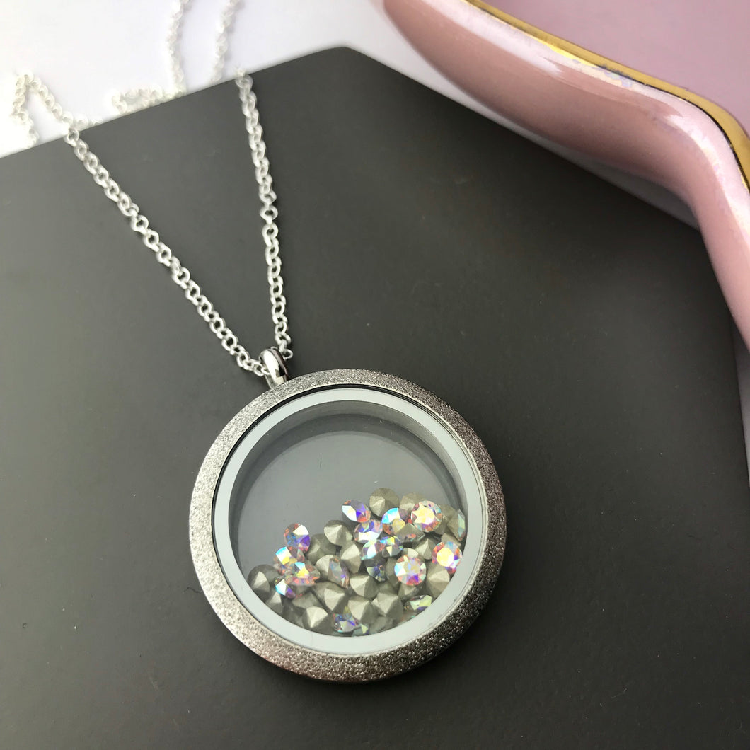 Stainless steel locket with Swarovski elements crystals on sterling silver chain.