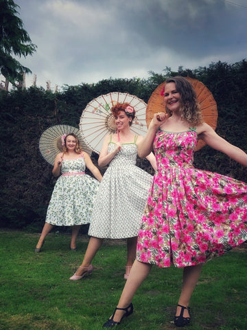 Front to back-Anya, Irene and Rach in a 'social distanced' photo wearing their self made Marilyn Dress