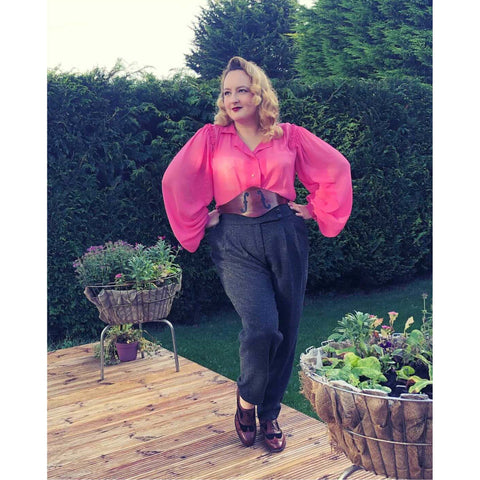 Ms Carnivale wearing a bautiful pink blouse with billowing sleeves made from fabric from Amo Threads
