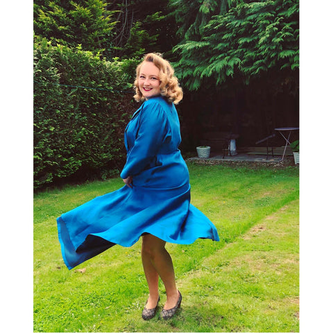 Ms Carnivale wearing a blu silk coachman robe housecoat made using our graded pattern and fabric from Amo threads