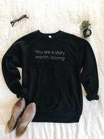 You are a Story Worth Loving Comfort Colors Black Sweatshirt