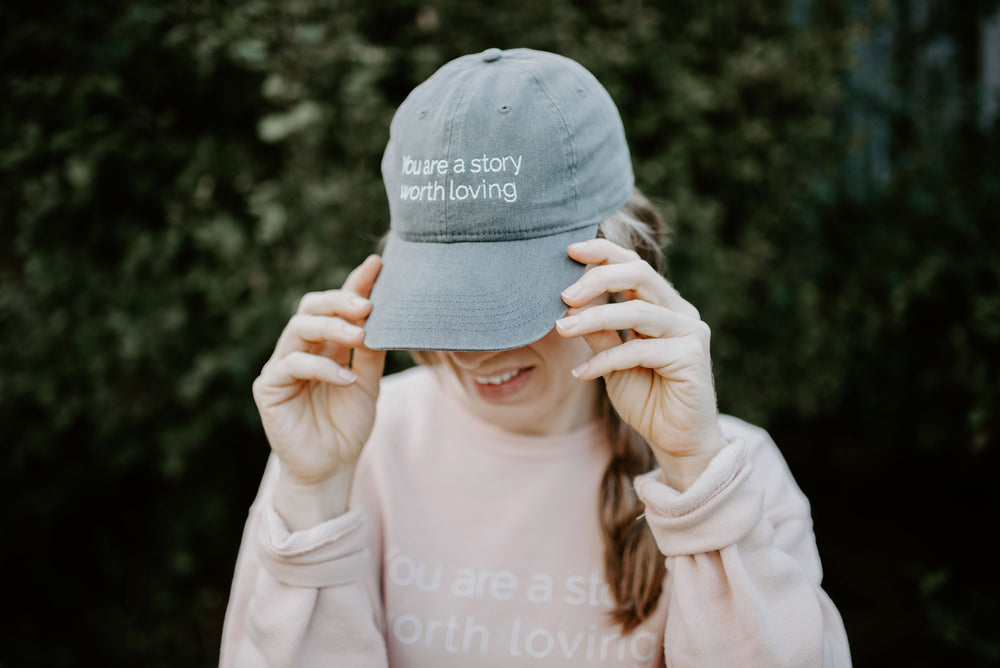 You are a Story Worth Loving Baseball Cap. Comfort Colors grey. Grace Presley