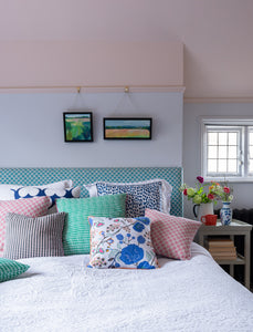 Bright and colourful cushions on a bed