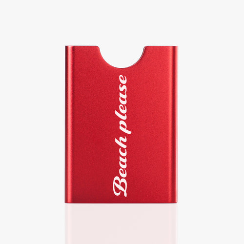 Red Thin King credit card holder with a text Beach Please