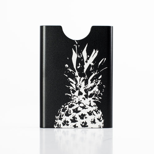 Thin King aluminum credit card case with laser engraved pineapple graphic