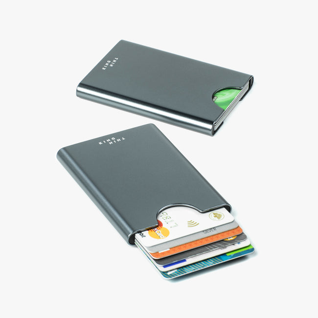 Titan gunmetal color Thin King EDC card holder with 6 credit cards inside