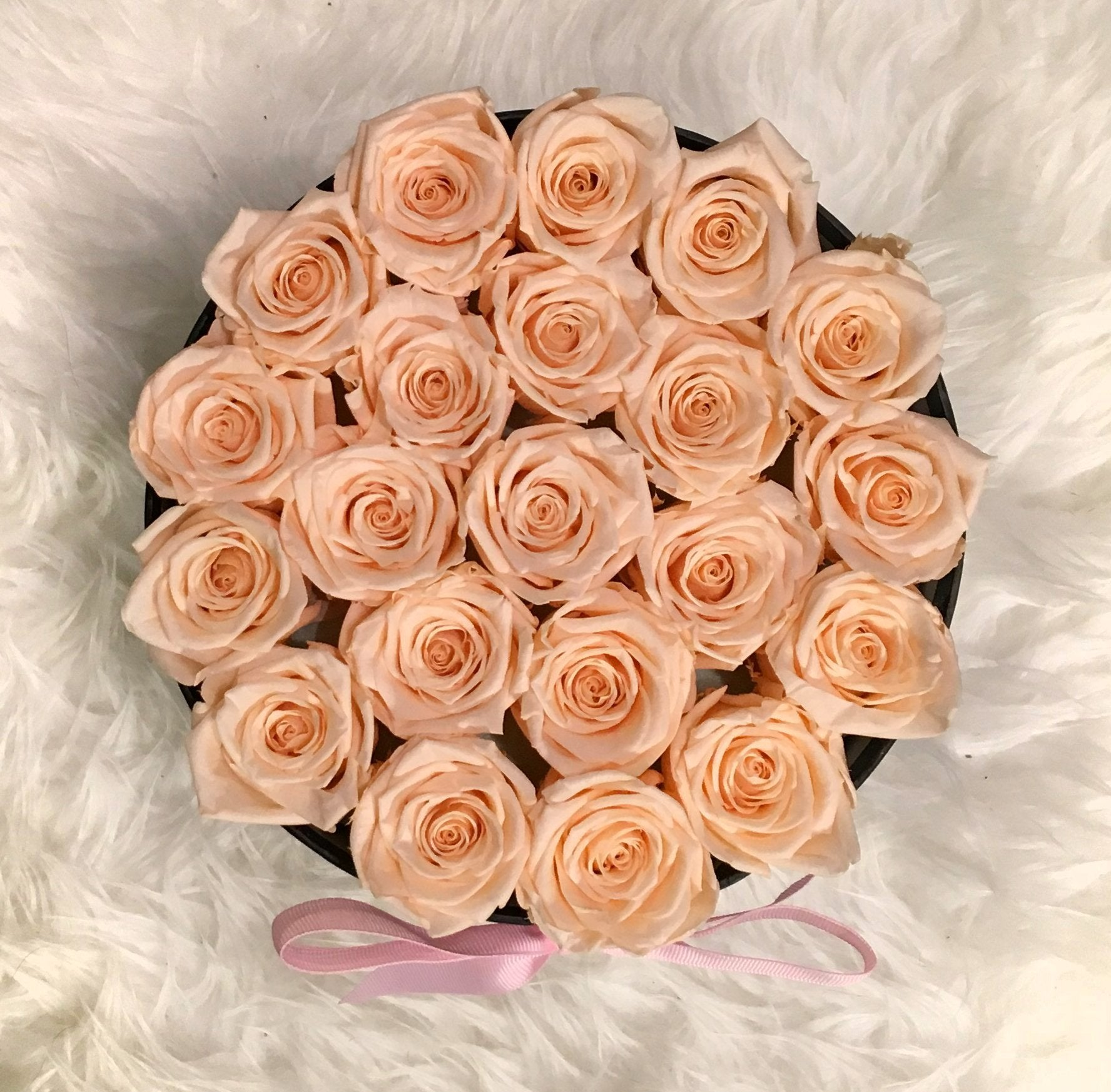 19-23 Eternity Roses. Real roses preserved naturally with a proprietary solution to keep them stunningly beautiful for a year or more. No water or direct sunlight needed.