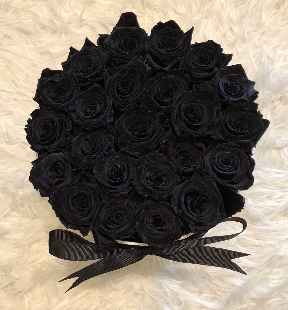 19-23 Black Eternity Roses. Real roses preserved naturally with a proprietary solution to keep them stunningly beautiful for a year or more. No water or direct sunlight needed.