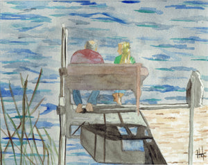 MAN AND WOMAN SITTING BY LAKE