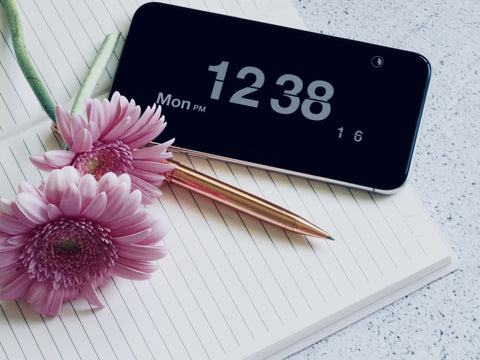 stationary, smartphone, notebook and flowers