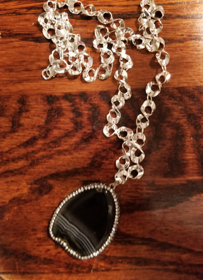 black agate slice banded with hematite and crystal on silvertone chain
