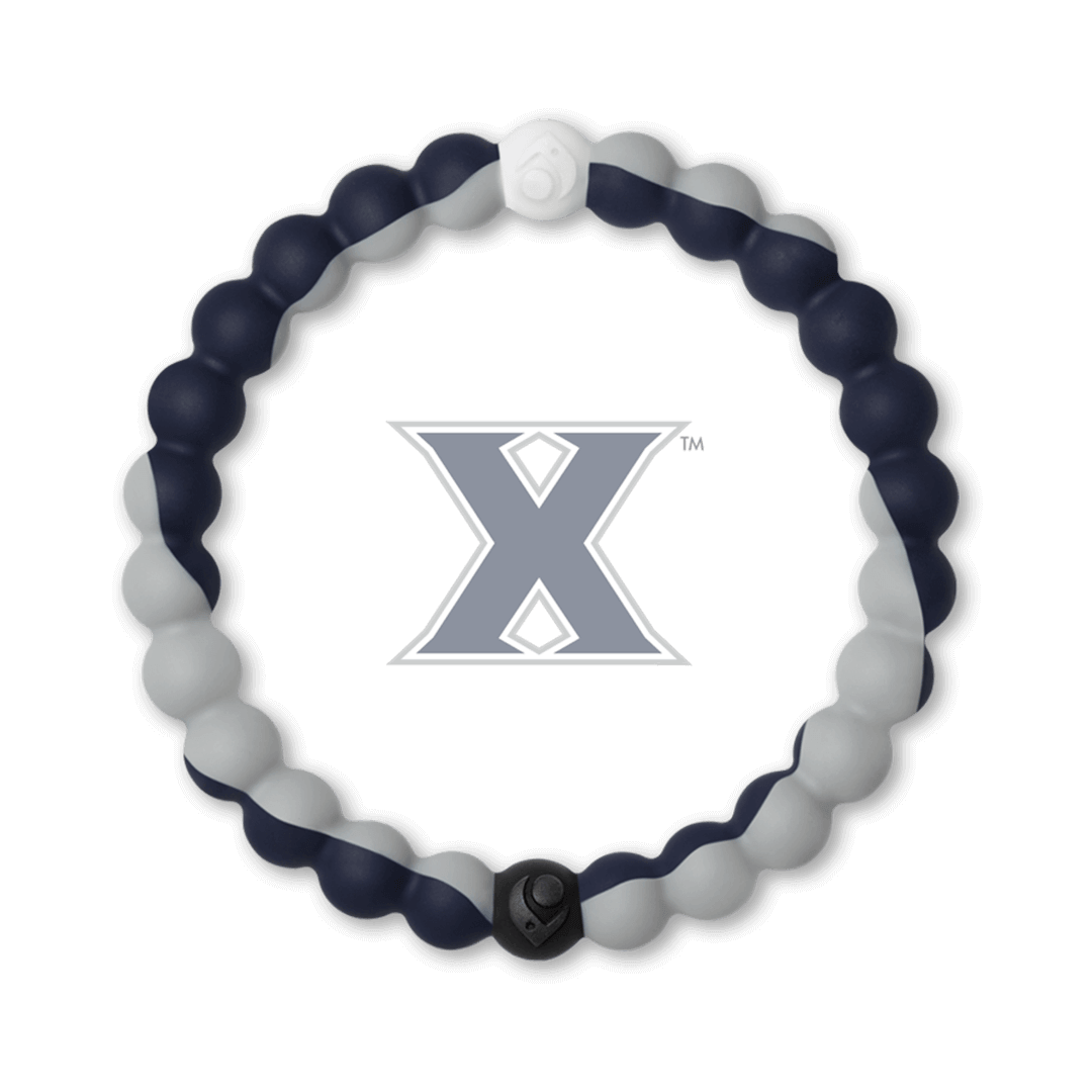 Gray and navy blue silicone beaded bracelet with the Xavier University logo in the center.