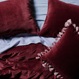 Kip & Co - Pomegranate Velvet Tassel Cushion - Playhaus Interiors