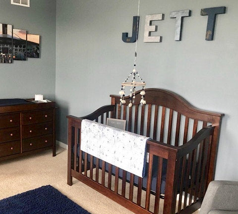 Boy nursery decor and custom name letters spelling out Jett.