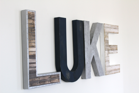 Custom name letters spelling out Luke in silver, navy, and white.