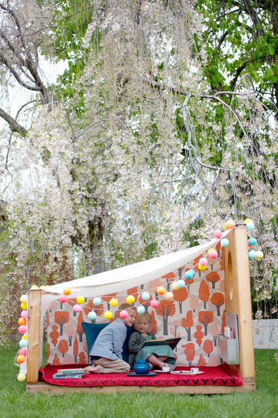 Fun String lighting used in a boys outdoor tent play space for toddler room decor.