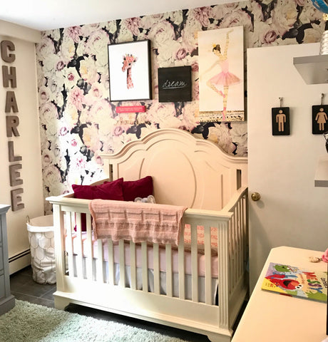 Girls ballerina nursery room with custom wall name letters in rose gold.
