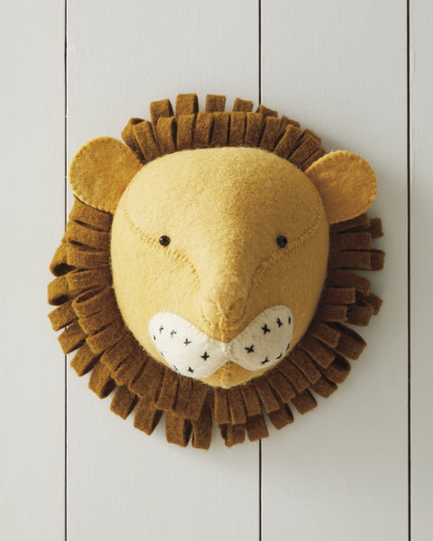 Adorable plush animal lion head for toddler room decor ideas.