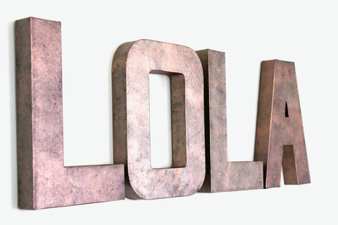 Rose gold pink custom wall name letters spelling out Lola.