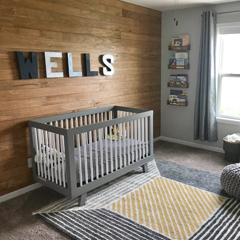 Custom wall name letters spelling out Wells in a rustic industrial nursery.