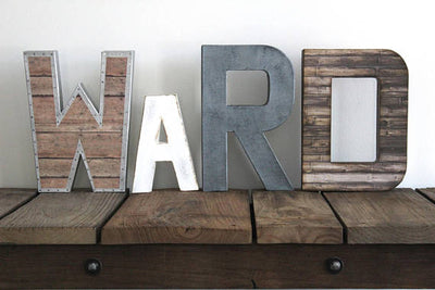 Reclaimed faux wooden nursery letters in a farmhouse style.