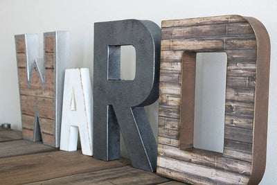 WARD nursery boy name letters in an industrial metal finish.