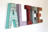 ALICE girl name letters mounted on the wall in different colors for a whimsical look