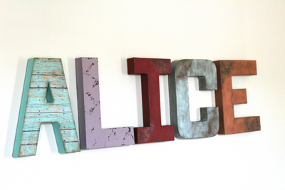 """Wooden"" distressed letters in different colors spelling out the name ALICE"