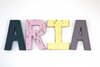 "Colorful ""wooden"" girls name letters spelling out ARIA."