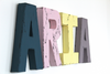 ARIA colorful name letters in blue, pink, yellow, and purple.