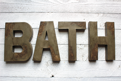 Bath letters in gray in a distressed style.