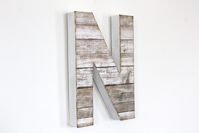 "White beach ""wooden"" letter N with a reclaimed wood look."