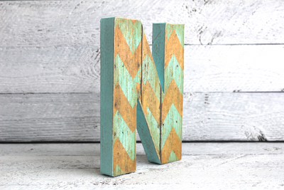 blue and brown chevron wooden letter N in a bohemian style