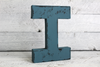 dark blue distressed letter I in a vintage style