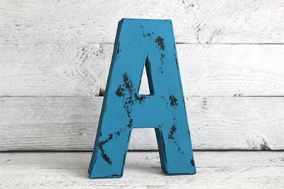 bright blue vintage style wooden letter.