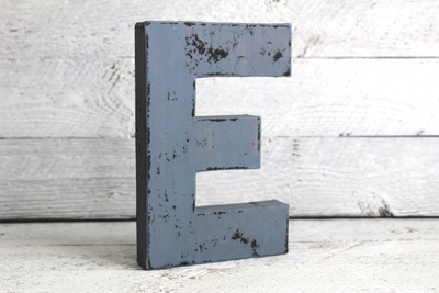 dark blue wooden letter with black distressing