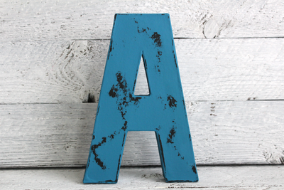 distressed blue wooden letter A in a vintage style.