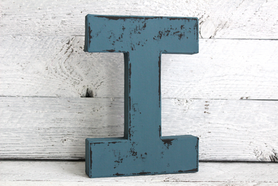 blue wooden letter I in a distressed finish.
