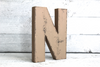 Brown letter N in a vintage distressed style