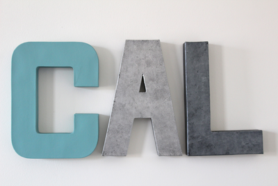 Baby boy nursery name sign in blue, silver, and gray.