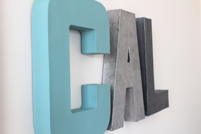 Cal nursery letters for boys room decor in blue, silver, and grey.