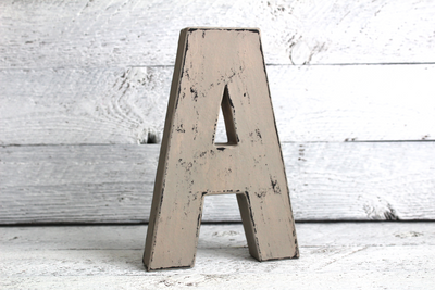 Wooden Grey letter A against a wooden background