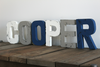 "Boy room ""wooden"" nursery name letters in white, gray, and navy colors."